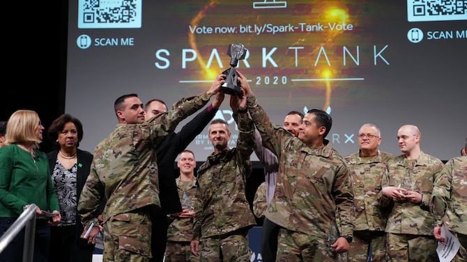 group of Airmen hold up trophy