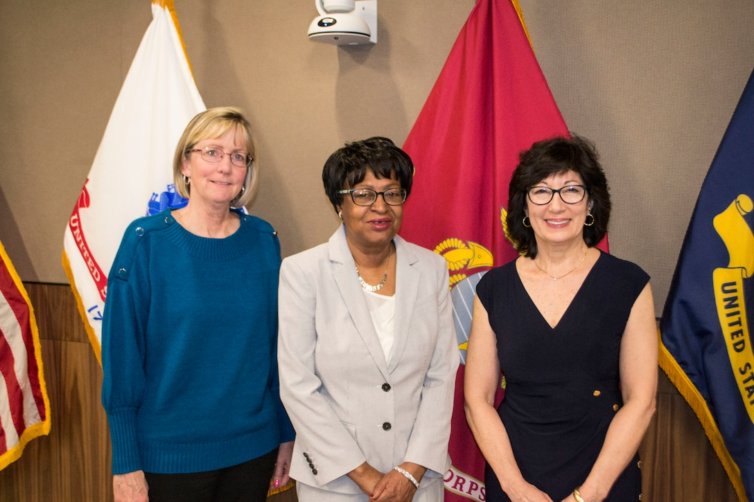 Three female adults who have recently retired from the Defense Logistics Agency Troop Support in Philadelphia are pictured.