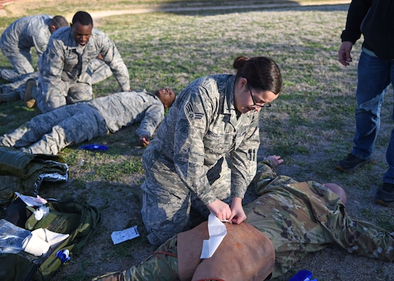 U.S. Air Force medics with the 17th Medical Group perform various first aid to simulated casualties during the Tactical Combat Casualty Care course at Goodfellow Air Force Base, Texas, Feb. 21, 2020. TCCC training has four levels of qualification, tiers one through three are for all other service members and tier four is for medical providers. (U.S. Air Force photo by Airman 1st Class Ethan Sherwood)