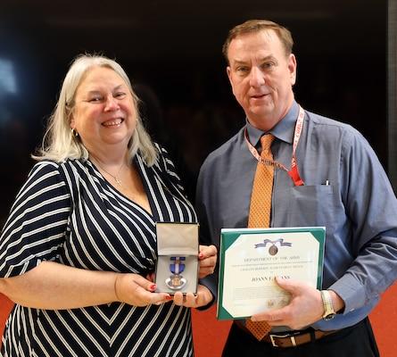 Jo-Ann Evans receives a Civilian Service Achievement Medal.