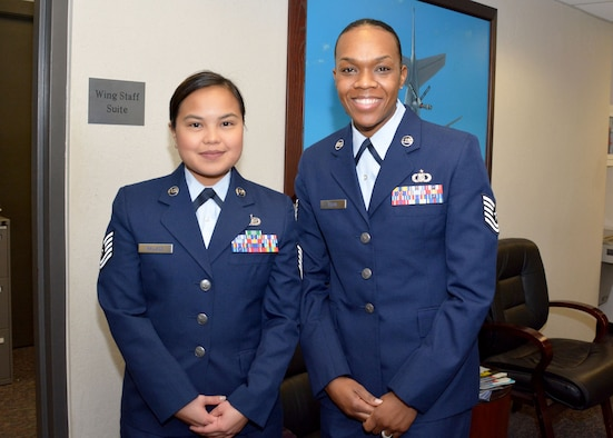 Two Airmen at the commissioning board