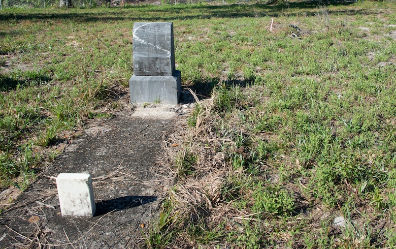 Pictured is one of the few marked graves in Massalina Cemetery at Tyndall Air Force Base, Florida, Feb. 28, 2020. Belle Massalina was buried in 1911. (U.S. Air Force photo by 2nd Lt. Kayla Fitzgerald)