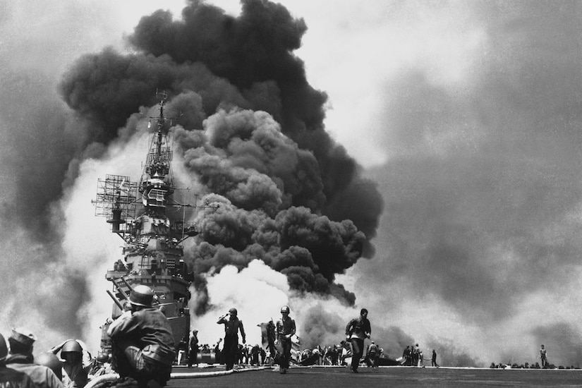 Smoke billows from a burning ship.