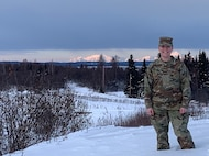 Air Force Senior Airman Alaina Armentrout poses for the camera with Denali in the background, January 30, 2020 at Joint Base Elmendorf-Richardson, Alaska. Armentrout is assigned to the 381st Intelligence Squadron as a cryptologic language analyst.