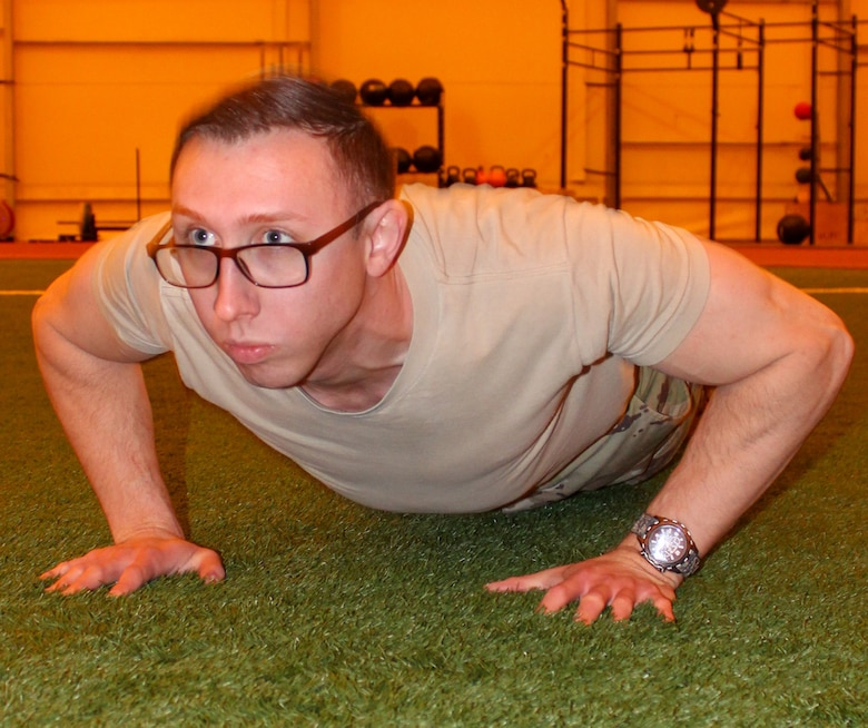 First Lt. Michael Horvat, 2nd Space Operation Squadron lead mission analyst, performs a push up at the indoor running track at Schriever Air Force Base, Colorado Feb. 27, 2020. Horvat will run for the first time in the Bataan Memorial Death March 15 in White Sands Missile Range, New Mexico. (U.S. Air Force photo by Marcus Hill)