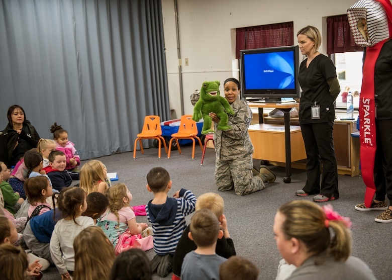 The 412th Medical Group's Tech. Sgt. Halima Burton and Lanie Sheffield give a class on proper teeth-brushing techniques at the Child Development Center on Edwards Air Force Base, California, Feb. 28. (Air Force photo by Giancarlo Casem)