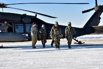 A U.S. Army Soldier teaches 354th Security Forces Squadron (SFS) defenders how to properly remove a casualty from a UH-60 Blackhawk during a medical evacuation (MEDEVAC) exercise on Eielson Air Force Base, Alaska, Feb. 26, 2020. The 354th SFS partnered with 1-52D General Support Aviation Battalion to be able to simulate a real world MEDEVAC. (U.S. Air Force photo by Senior Airman Beaux Hebert)