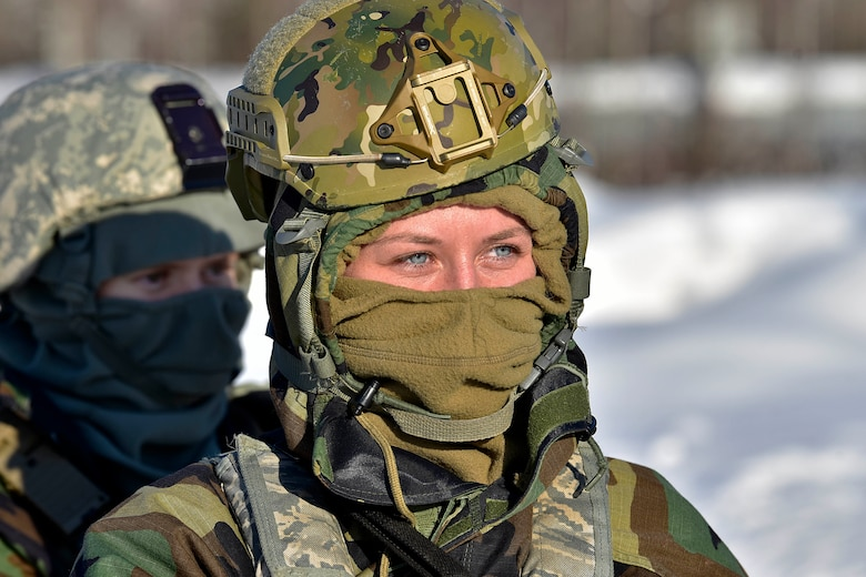 Senior Airman Sierra Warriner, 354th Security Forces Squadron installation entry controller, listens to a brief during a medical evacuation exercise on Eielson Air Force Base, Alaska, Feb. 26, 2020. Defenders donned cold-weather and mission oriented protective posture (MOPP) gear as part of the exercise. (U.S. Air Force photo by Senior Airman Beaux Hebert)