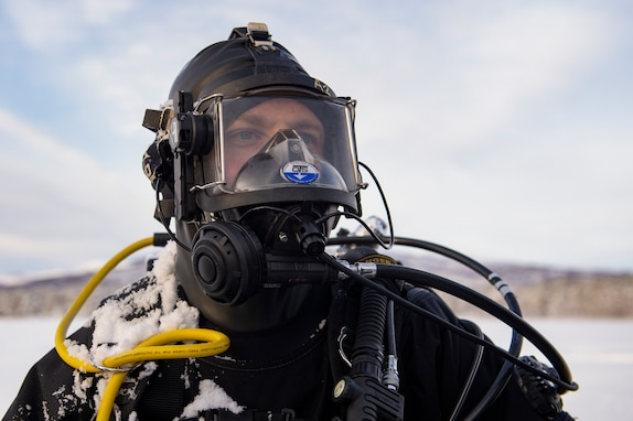 Construction Electrician 2nd Class Evan Reese assigned to Underwater Construction Team One (UCT-1), part of Navy Expeditionary Combat Force Europe-Africa/Task Force (CTF) 68, conducts ice dive operations at a frozen lake in Skjold, Norway during Exercise Cold Response 2020.