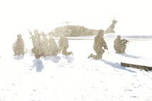354th Security Forces Squadron defenders hold a perimeter around a simulated casualty while a UH-60 Blackhawk lands during a medical evacuation (MEDEVAC) exercise on Eielson Air Force Base, Alaska, Feb. 26, 2020. While waiting for the MEDEVAC, defenders must hold a perimeter around the casualty until help arrives. (U.S. Air Force photo by Senior Airman Beaux Hebert)