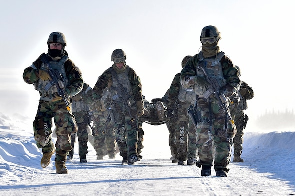 354th Security Forces Squadron defenders carry a simulated casualty during a medical evacuation exercise on Eielson Air Force Base, Alaska, Feb. 26, 2020. The defenders simulated taking small-arms fire and evacuating a casualty to a UH-60 Blackhawk assigned to the 1-52D General Support Aviation Battalion. (U.S. Air Force photo by Senior Airman Beaux Hebert)