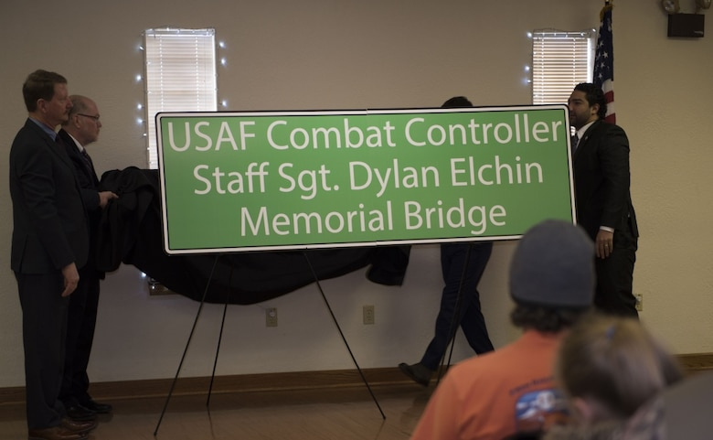 "Pennsylvania Senator Elder Vogel Jr. and his staff unveil the newly named ""USAF Combat Controller Staff Sgt. Dylan Elchin Memorial Bridge"" at a ceremony in Rochester, Pa. Feb 29, 2020. The bridge honors the service of Special Tactics combat controller Staff Sgt. Dylan Elchin who was killed in action alongside two U.S. Army Special Forces members when their vehicle struck an improvised explosive device in Ghazni Province, Afghanistan, Nov. 27, 2018."