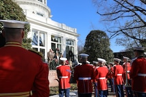 """On Jan. 1, 2020, at Marine Barracks Washington, D.C., the Marine Band performed the """"Surprise Serenade"""" for the 38th Commandant of the Marine Corps General David H. Berger. A tradition that dates back to the mid-1800s, the ensemble performed The Marines' Hymn, """"Bless this House,"""" and """"Semper Fidelis.""""  Following the serenade, the band was invited into the Home of the Commandants for a tour. (U.S. Marine Corps photos by Master Gunnery Sgt. Amanda Simmons/released)"""