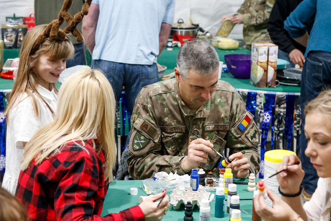 """NATO Soldiers give local children holiday cheer during """"Operation Christmas"""""""