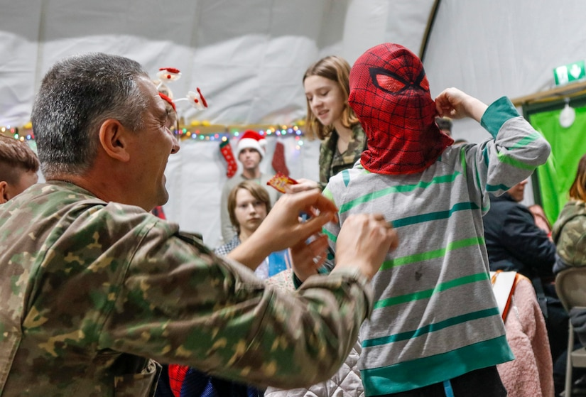 "NATO Soldiers give local children holiday cheer during ""Operation Christmas"""