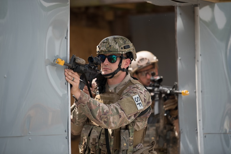 Staff Sgt. Cameron Blankenship, a fire team leader from the Kentucky Air National Guard's 123rd Security Forces Squadron, executes a simulated short-notice mission to degrade terrorist capabilities during a field training exercise at Fort Knox, Ky., May 21, 2019. The exercise was designed to test security tactics in a simulated Afghan village from May 18-22. (U.S. Air National Guard photo by Phil Speck)