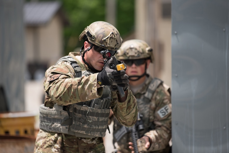 Staff Sgt. Joseph Howell,  a fire team member from the Kentucky Air National Guard's 123rd Security Forces Squadron, leads a simulated short-notice mission to degrade terrorist capabilities during a field training exercise at Fort Knox, Ky., May 21, 2019. The exercise was designed to test security tactics in a simulated Afghan village from May 18-22. (U.S. Air National Guard photo by Phil Speck)