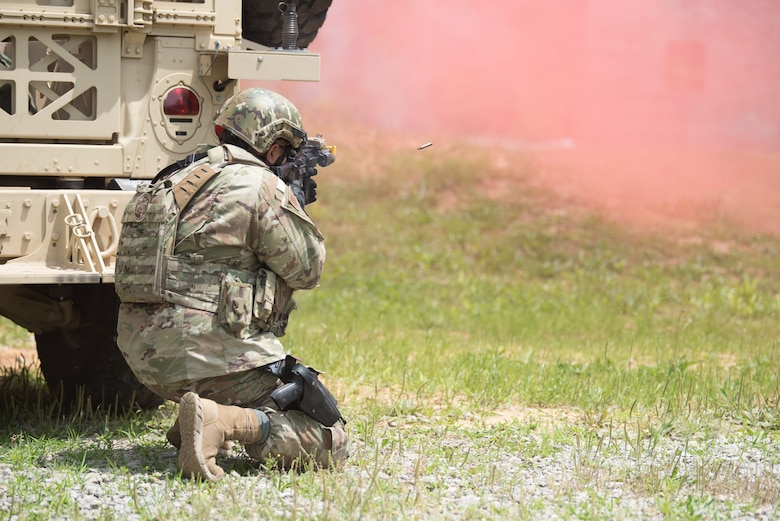 A member of the Kentucky Air National Guard's 123rd Security Forces Squadron lays down suppressive fire during a field training exercise at Fort Knox, Ky., May 21, 2019. The exercise was designed to test security tactics in a simulated Afghan village from May 18-22. (U.S. Air National Guard photo by Phil Speck)
