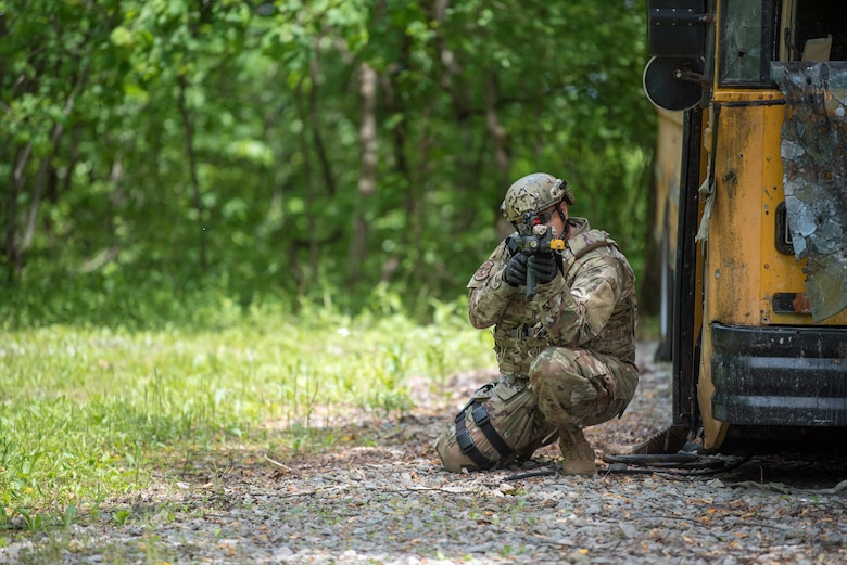 Tech. Sgt. Alejandro Rendon, a squad leader from the Kentucky Air National Guard's 123rd Security Forces Squadron, executes a simulated short-notice mission to degrade terrorist capabilities during a field training exercise at Fort Knox, Ky., May 21, 2019. The exercise was designed to test security tactics in a simulated Afghan village from May 18-22. (U.S. Air National Guard photo by Phil Speck)