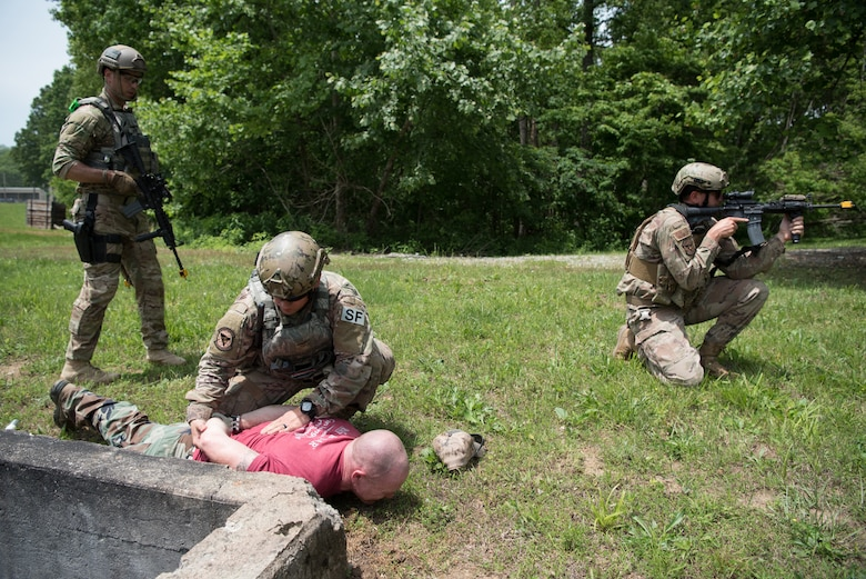Members of the Kentucky Air National Guard's 123rd Security Forces Squadron detain a simulated enemy combatant during a field training exercise at Fort Knox, Ky., May 21, 2019. The exercise was designed to test security tactics in a simulated Afghan village from May 18-22. (U.S. Air National Guard photo by Phil Speck)