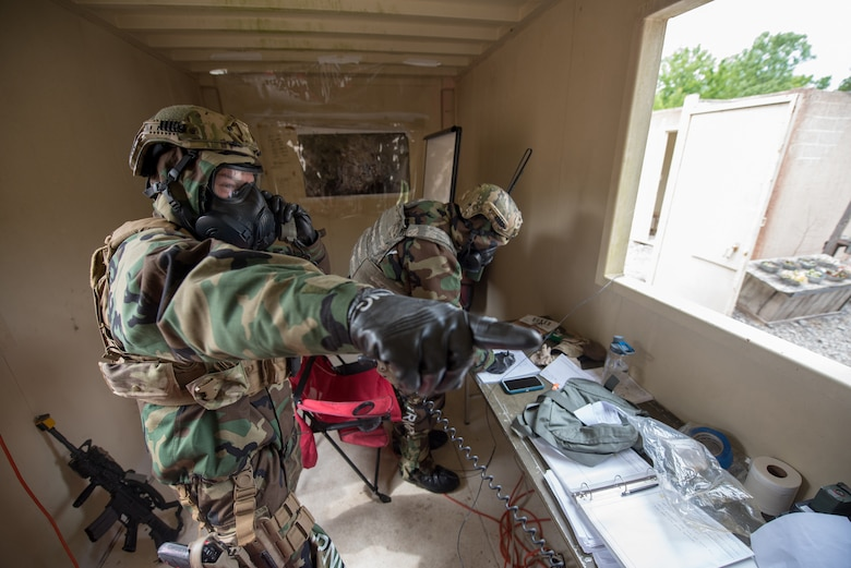 Members of the Kentucky Air National Guard's 123rd Security Forces Squadron perform base defense operations during a field training exercise at Fort Knox, Ky., May 21, 2019. The exercise was designed to test security tactics in a simulated Afghan village from May 18-22. (U.S. Air National Guard photo by Phil Speck)