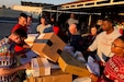 U.S. Soldiers who serve as mail clerks in the 30th Armored Brigade Combat Team, sort and load packages at the Camp Buehring post office in Kuwait on Christmas Day, Dec. 25, 2019. The unit is comprised of more than 4,000 Citizen-Soldiers from the North Carolina, South Carolina, Ohio and West Virginia National Guard deployed to the Middle East to support Operation Spartan Shield.  (U.S. Army National Guard photo by Lt. Col. Cindi King)
