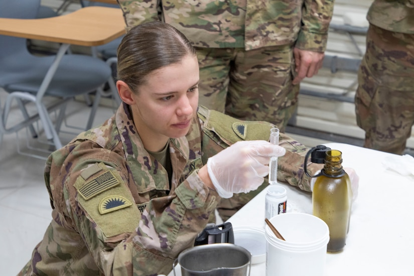 U.S. Army Spc. Shelby Vermeulen, with 1st Squadron, 303rd Cavalry Regiment, 96th Troop Command, Washington Army National Guard, works through the steps of water purification during a Field Sanitation Team Certification Course held from Dec. 9 to Dec.13, 2019 at Joint Training Center-Jordan. Soldiers must be ready and capable to conduct the full range of military operations to defeat all enemies regardless of the threats they pose. (U.S. Army photo by Shaiyla B. Hakeem)