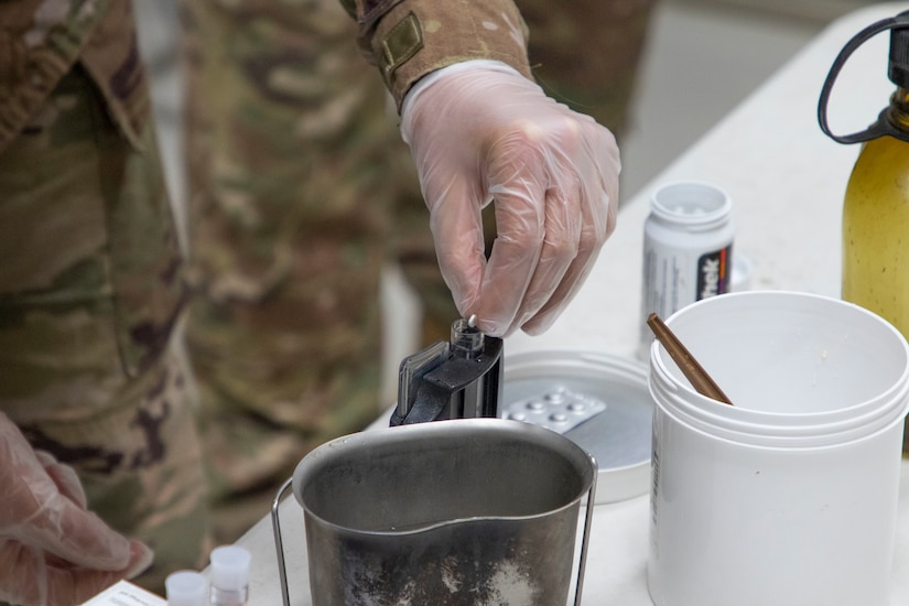 U.S. Army Spc. Shelby Vermeulen, with 1st Squadron, 303rd Cavalry Regiment, 96th Troop Command, Washington Army National Guard, drops a chlorine tablet into water during a Field Sanitation Team Certification Course held from Dec. 9 to Dec.13, 2019 at Joint Training Center-Jordan. Soldiers must be ready and capable to conduct the full range of military operations to defeat all enemies regardless of the threats they pose. (U.S. Army photo by Shaiyla B. Hakeem)