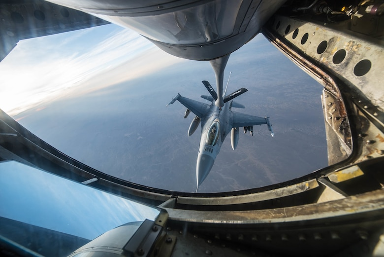 Master Sgt. Phil Speck, superintendent of the 123rd Airlift Wing Public Affairs Office, earned third place in the 2018 Air National Guard Military Photographer of the Year contest for a broad spectrum of work while deployed and at home station, including this photo of an F-16 Fighting Falcon refueling in the skies over Afghanistan Jan. 17, 2018. (U.S. Air National Guard photo by Master Sgt. Phil Speck)