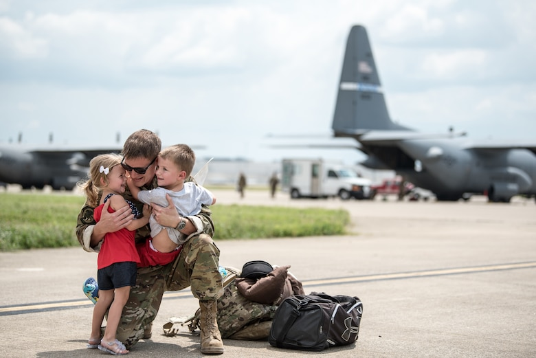 Master Sgt. Phil Speck, superintendent of the 123rd Airlift Wing Public Affairs Office, earned third place in the 2018 Air National Guard Military Photographer of the Year contest for a broad spectrum of work while deployed and at home station, including this photo of a deployment homecoming in Louisville, Ky., July 6, 2018. (U.S. Air National Guard photo by Master Sgt. Phil Speck)