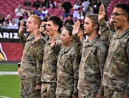 Future Soldiers from the Phoenix Recruiting Battalion, National Guard and Marines, recite the Oath of Enlistment during a mass enlistment ceremony Dec. 1, 2019, at State Farm Stadium, Glendale, Ariz. The ceremony took place shortly before a National Football League football game between the Arizona Cardinals and Los Angeles Rams. (Photo Credit: Alun Thomas)