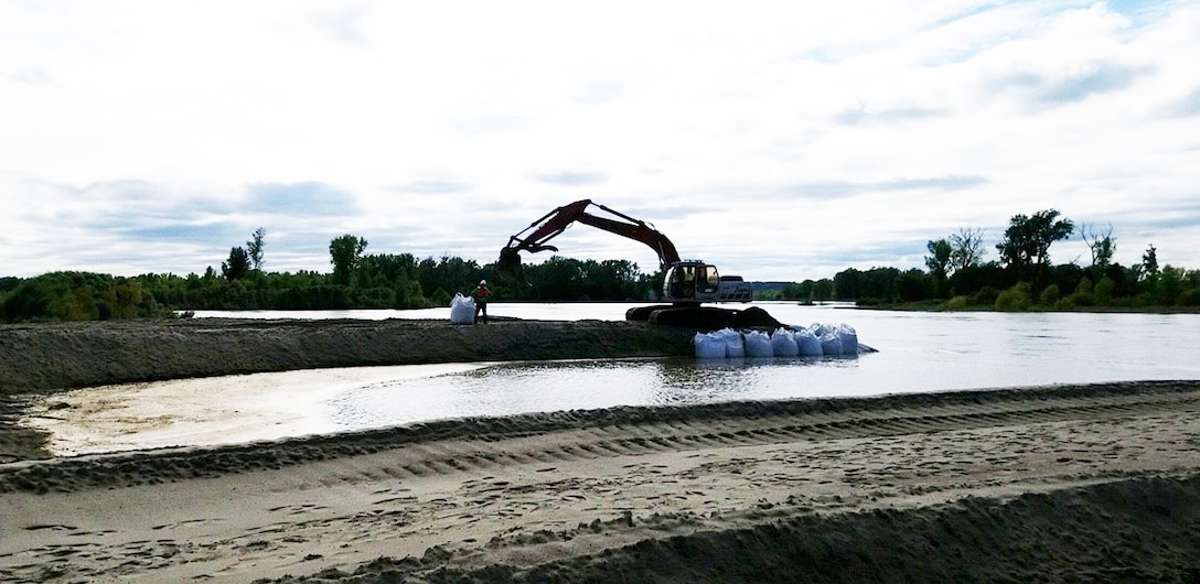 Flood fighting efforts are taken Sept. 22 to protect completed repair efforts from rising high water along the L-575 Missouri River Levee System where initial breach repairs were being made.