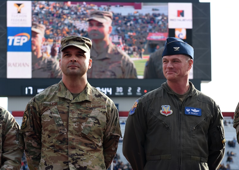 Photo of Davis-Monthan Air Force Base, Arizona leadership being recognized at the Arizona Bowl football game