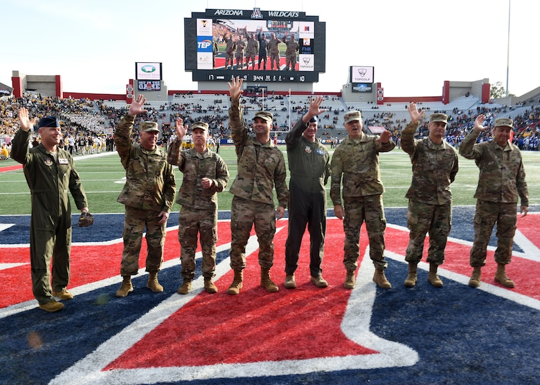 Photo of Arizona servicemembers being recognized on a field at the Arizona Bowl football game