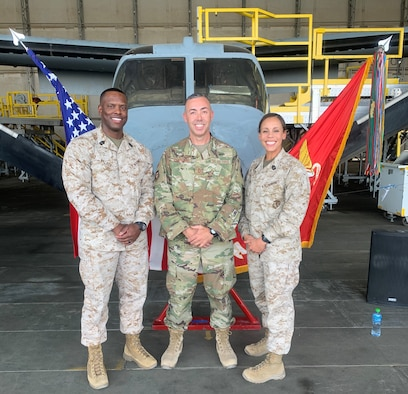 Marine First Sergeant Percy E. Walker, U.S. Marine Corps, Special Purpose Marine Air-Ground Task Force – Crisis Response – Central Command, left; Senior Master Sgt. John V. McDonald, 407th Expeditionary Support Squadron first sergeant; and First Sergeant Angela J. Lopez, USMC, SPMAGTF-CR-CC, pose in front of a MV-22 Osprey display during the United States Marine Corps 244th Birthday Ceremony at Ahmed Al Jaber Air Base, Kuwait, Nov. 7, 2019. On Nov. 10, 1775, the Continental Marines were established. (Courtesy photo)