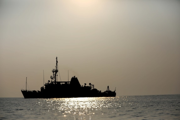 Mine countermeasures ship USS Devastator (MCM 6) navigates through the Arabian Gulf. Devastator is deployed to the U.S. 5th Fleet area of operations in support of Operation Sentinel