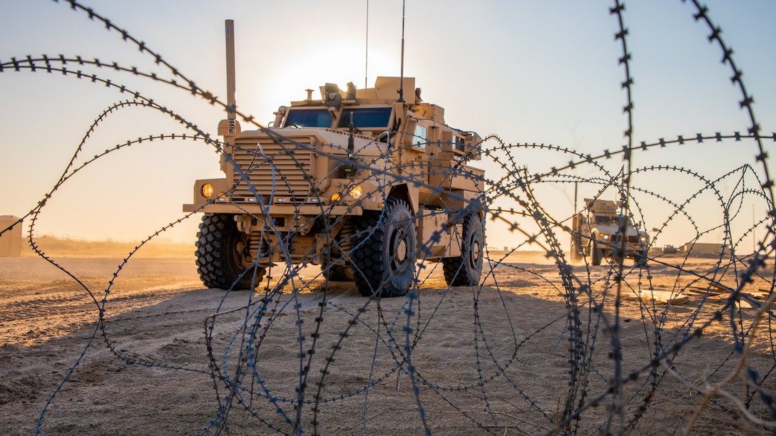 U.S. Marines drive Mine Resistant Ambush Protected All-Terrain Vehicles during a tactical vehicle driving course in Kuwait, Dec. 21.