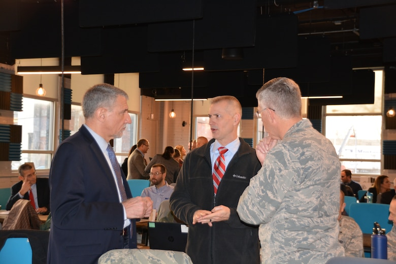 Dr. Kevin Geiss, Airman Systems Directorate director, talks with Dr. David Neri, Air Force Medical Service Chief Scientist, and Col. LaFrance during the inaugural Physiological Episodes Mitigation Technology Summit and Industry Day in Dayton, Ohio, Dec. 17-18.