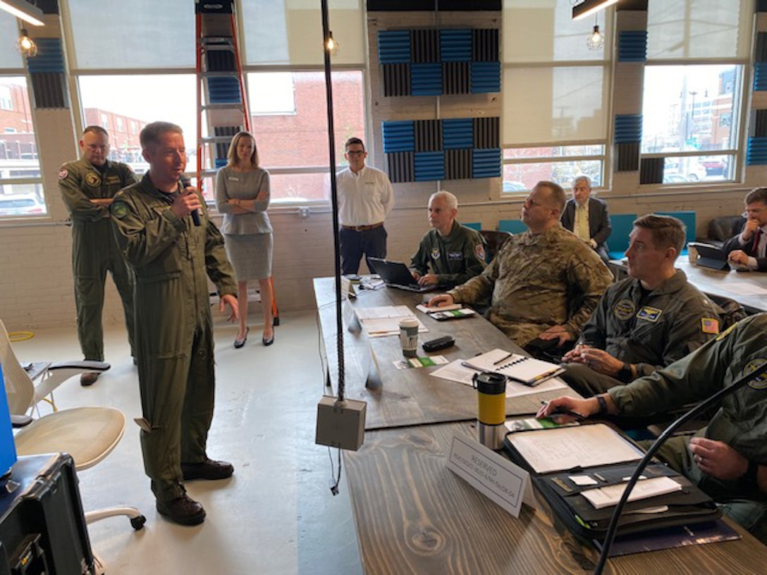 Air Force and Navy officials listen to a briefing during the Physiological Episodes Mitigation Technology Summit and Industry Day in Dayton, Ohio, Dec. 17-18.