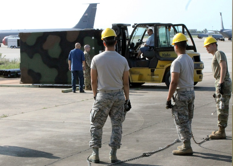 Airmen of the 752nd Operations Support Squadron unload the AN/TYQ-23A Tactical Air Operations Module weapons system as it arrives to Tinker Air Force Base in September 2019. The ground based weapons system allows squadron members at Tinker AFB to provide command and control to both live and simulated aircraft from around the country; being one of only four active duty bases to have this equipment.