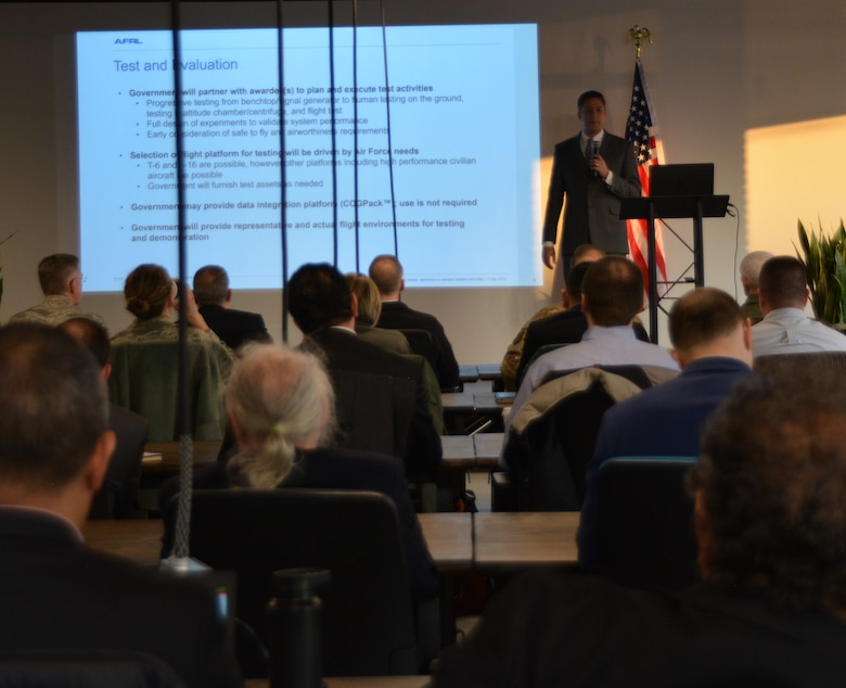 Dr. James Christensen, research psychologist with the Air Force Research Laboratory's 711th Human Performance Wing, gives a briefing Dec. 18 during the inaugural Physiological Episodes Mitigation Technology Summit and Industry Day in Dayton, Ohio.