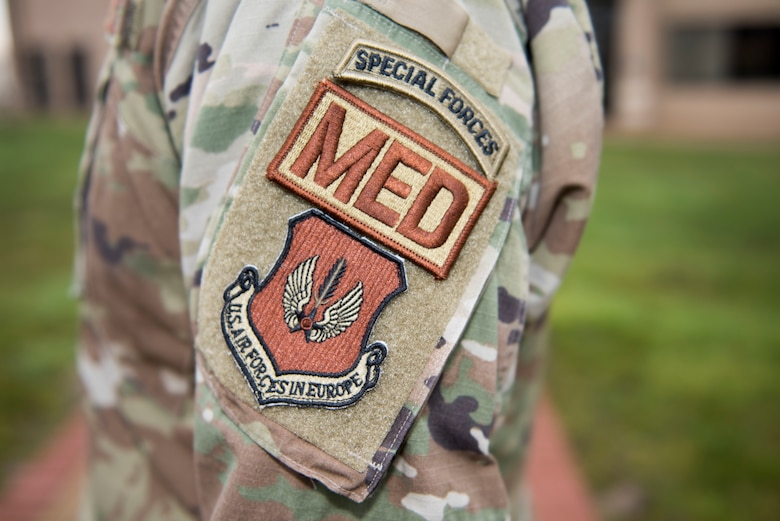 U.S. Air Force Lt. Col. Robert Heil, 422nd Medical Squadron commander, displays his military patches at the 423rd MDS clinic at RAF Alconbury, England, December 18, 2019. Heil spent 12 years in the Army as a Special Forces medic and now serves as an Air Force medical squadron commander in the 501st Combat Support Wing. (U.S. Air Force photo by Airman 1st Class Jennifer Zima)