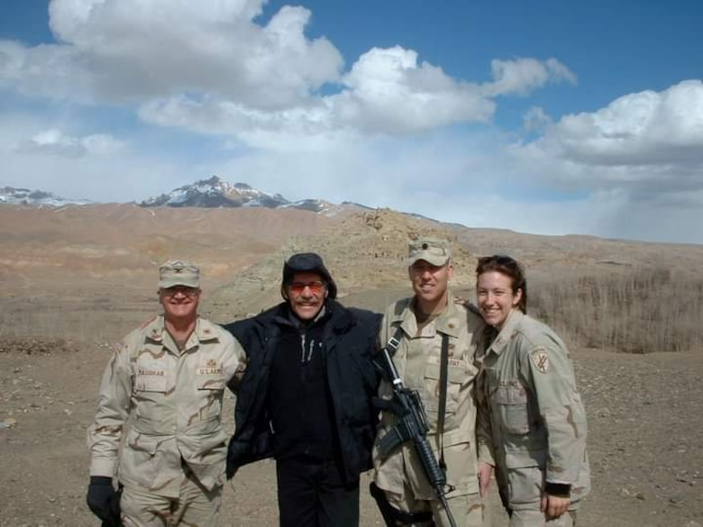 Now-Air Force Lt. Col. Elizabeth Hoettels, 423rd Medical Squadron commander, poses for a photo during a deployment in Afghanistan in front of Ghenghis Khan's castle during her prior career as an Army Civil Affairs officer. Hoettels served 10 years in the Army before transitioning to the Air Force. (Courtesy photo)