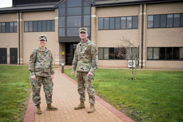 U.S. Air Force Lt. Col. Elizabeth Hoettels, 423rd Medical Squadron commander, and Lt. Col. Robert Heil, 422nd Medical Squadron commander, pose for a photo at the 423rd MDS clinic at RAF Alconbury, England, December 18, 2019. Hoettels and Heil share similar backgrounds in Army Special Forces and now serve as Air Force medical squadron commanders in the 501st Combat Support Wing. (U.S. Air Force photo by Airman 1st Class Jennifer Zima)