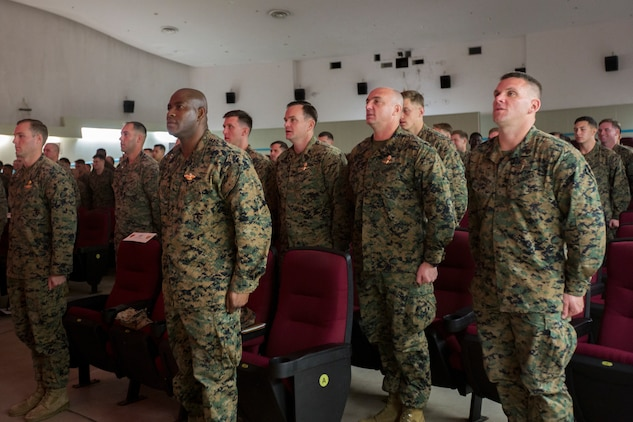 U.S. Marines with 3rd Reconnaissance Battalion, 3rd Marine Division, stand at the position of attention during a relief and appointment ceremony at Camp Schwab, Okinawa, Japan, Dec. 18, 2019. This traditional ceremony symbolizes the passing of responsibilities from Sgt. Maj. Marcos A. Cordero to Sgt. Maj. Aaron Colling. (U.S. Marine Corps photo by Cpl. Cameron Parks)