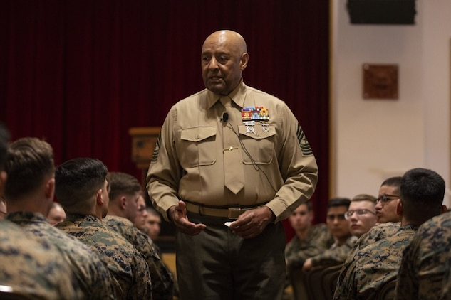 Retired Sgt. Maj. John Canley, Medal of Honor Recipient, speaks to Marines of the 31st Marine Expeditionary Unit and 3rd Marine Expeditionary Force on Camp Hansen, Okinawa, Japan, Dec. 11, 2019. Sgt. Maj. Canley received the Medal of Honor for his valor in combat during the Vietnam War. The 31st MEU, the Marine Corps' only continuously forward-deployed MEU, provides a flexible and lethal force ready to perform a wide range of military operations as the premier crisis response force in the Indo-Pacific region. (Official U.S. Marine Corps photo by Lance Cpl. Joshua Sechser)