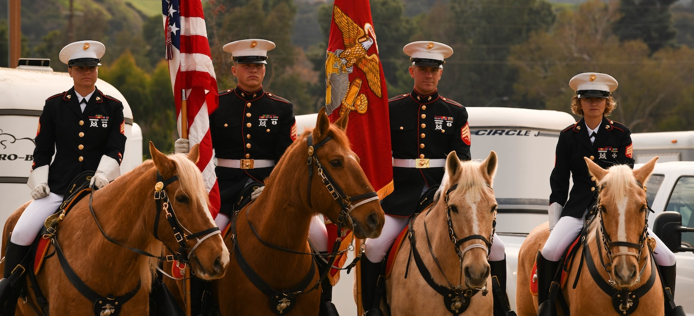 The Marine Corps Mounted Color Guard stand post during Equestfest in Burbank, California, Dec. 29.