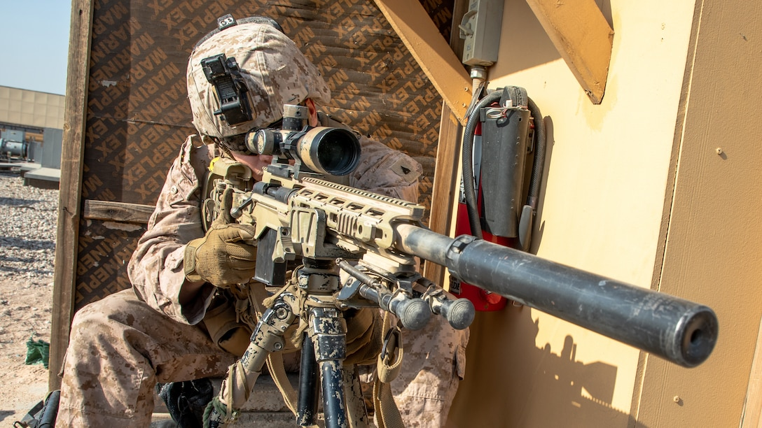 A U.S. Marine provides long-range over watch security with an M40A6 sniper rifle at the Baghdad Embassy Compound in Iraq, Jan. 3.