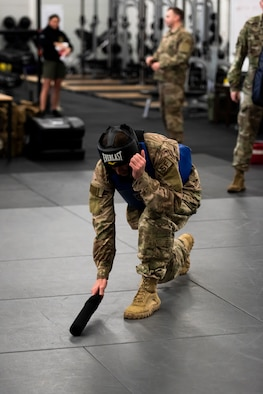 A U.S. Air Force Airman conducts the proper technique of picking up a baton to begin sparring during a Leader Led Training Course at Ramstein Air Base, Germany, Dec. 7, 2019. The Air Force designed the LLTC to teach Airmen how to use and train their own squadrons on what they learned. (U.S. Air Force photo by Staff Sgt. Devin Nothstine)