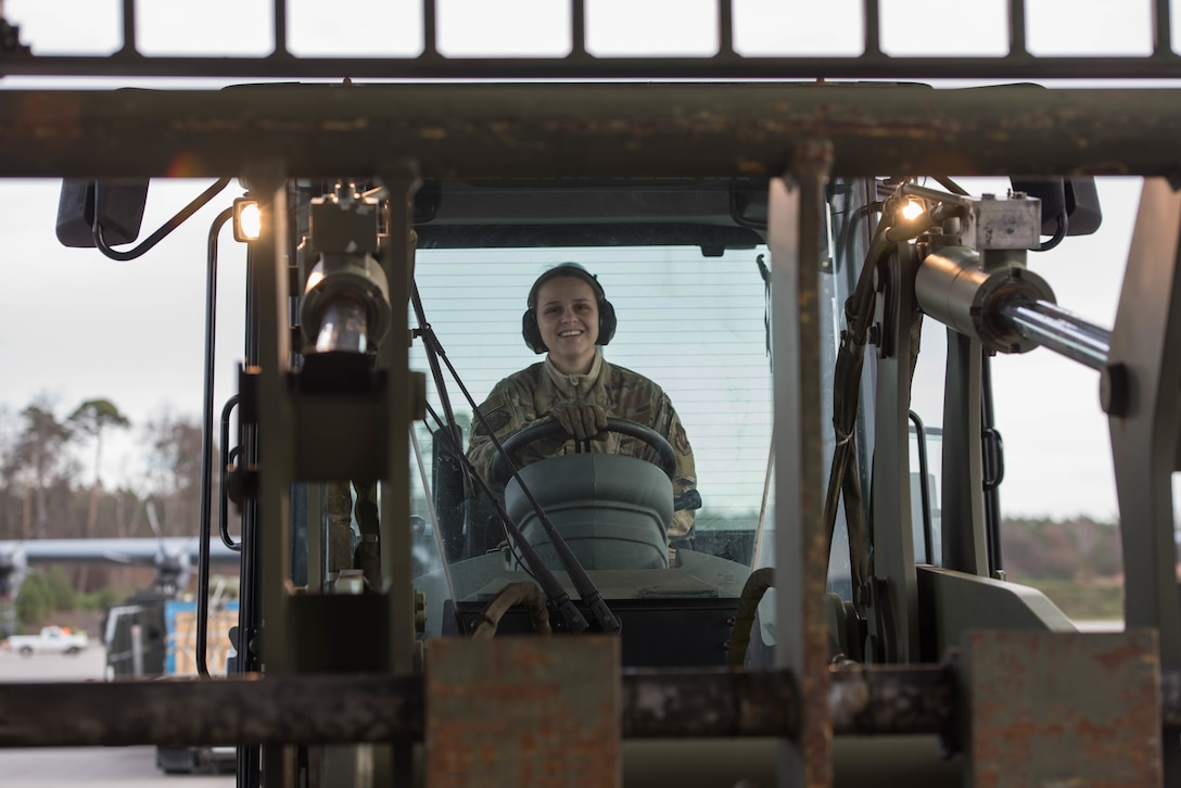 U.S. Air Force Airman First Class Cecilia Bak, 435th Contingency Response Squadron mobile aerial porter, smiles after loading a C-130J Super Hercules aircraft during Exercise Agile Wolf at Ramstein Air Base, Germany, Dec. 17, 2019. The 435th provides U.S. Air Forces in Europe's primary expeditionary aerial port capability and performs initial airfield operations enabling rapid standup of combat operations anywhere in the European theater. (U.S. Air Force photo by Staff Sgt. Devin Nothstine)